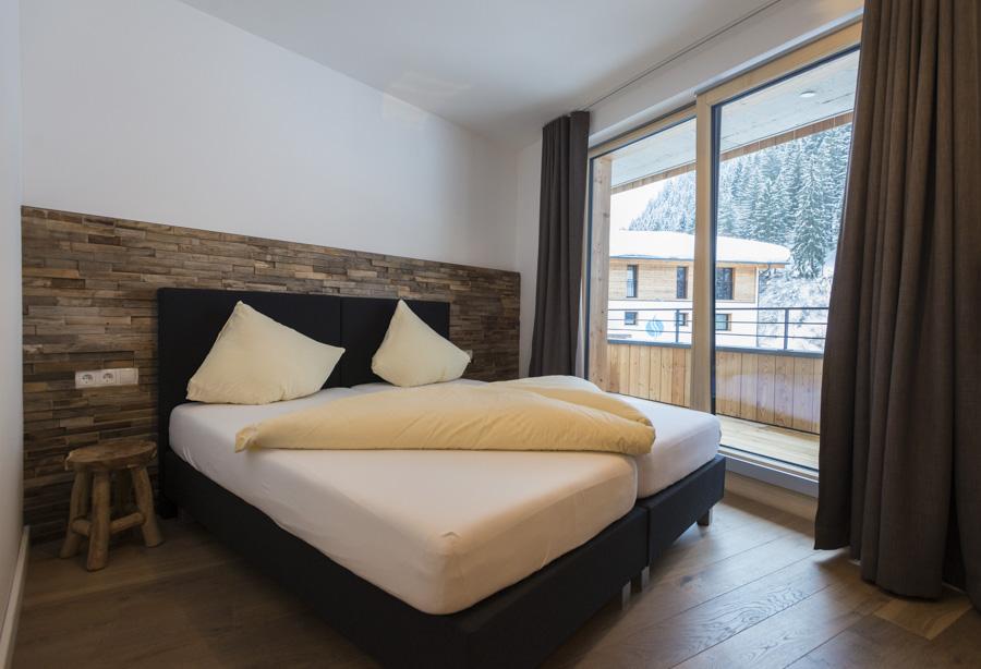 De slaapkamers van appartement Alpenrose beschikken over comfortabele tweepersoonsbedden.